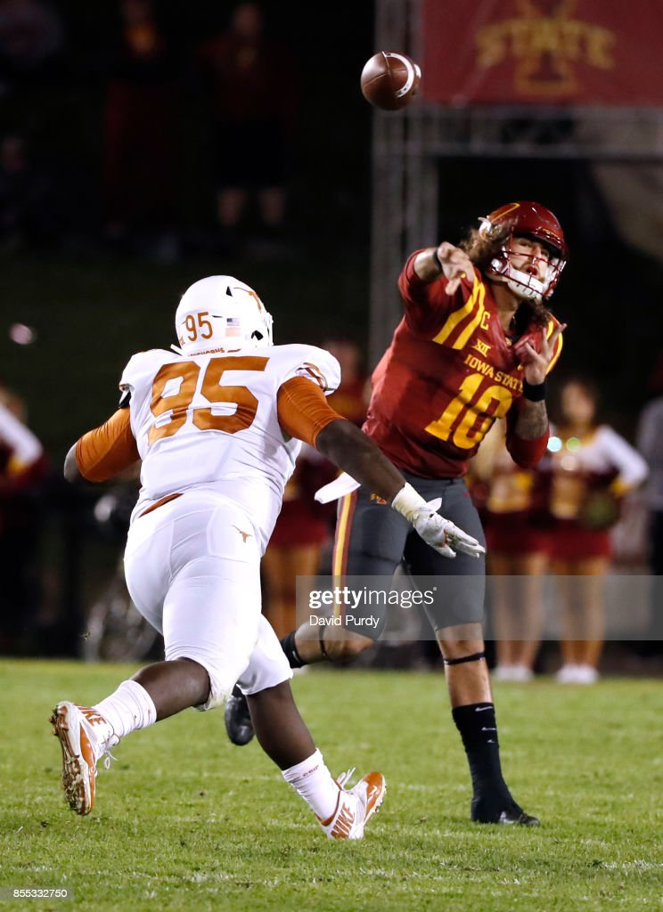 Quarterback Jacob Park #10 of the Iowa State Cyclones throws under pressure from defensive lineman Poona Ford #95 of the Texas Longhorns in the second half of play at Jack Trice Stadium on September 28, 2017 in Ames, Iowa. The Texas Longhorns won 17-7 over the Iowa State Cyclones.