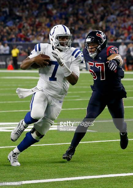 Quarterback Jacoby Brissett of the Indianapolis Colts celebrates rushing for a touchdown during the second quarter of the game against the outside...