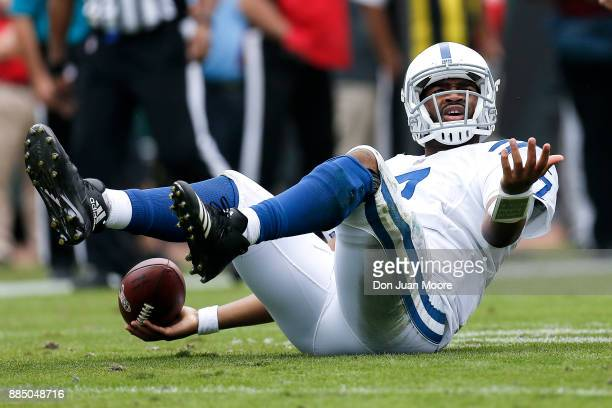 Quarterback Jacoby Brissett of the Indianapolis Colts looks at the officials for a roughing call during the game against the Jacksonville Jaguars at...