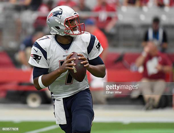 Quarterback Jacoby Brissett of the New England Patriots warms up before an NFL game against the Arizona Cardinals at University of Phoenix Stadium on...