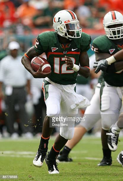 Quarterback Jacory Harris of the Miami Hurricanes looks for room to run while taking on the Wake Forest Demon Decons at Dolphin Stadium on October...