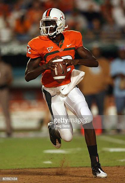 Quarterback Jacory Harris of the Miami Hurricanes scrambles against the Charleston Southern Buccaneers at Dolphin Stadium on August 28 2008 in Miami...