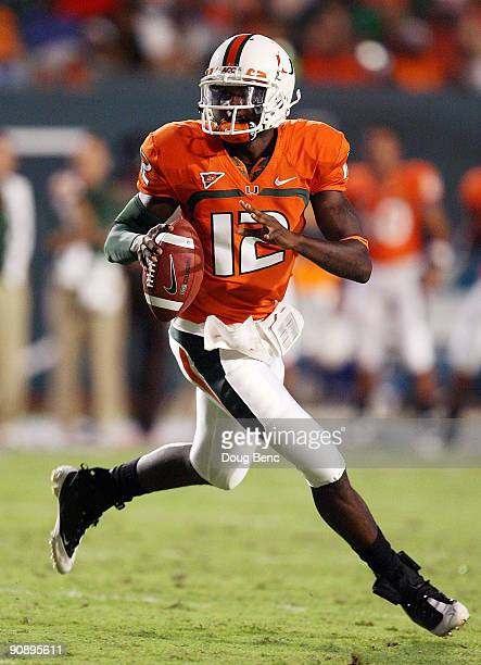 Quarterback Jacory Harris of the Miami Hurricanes scrambles against the Georgia Tech Yellow Jackets at Land Shark Stadium on September 17 2009 in...