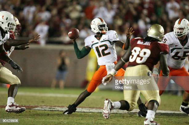 Quarterback Jacory Harris of the Miami Hurricanes throws a touchdown pass in the fourth quarter to Graig Cooper against the Florida State Seminoles...