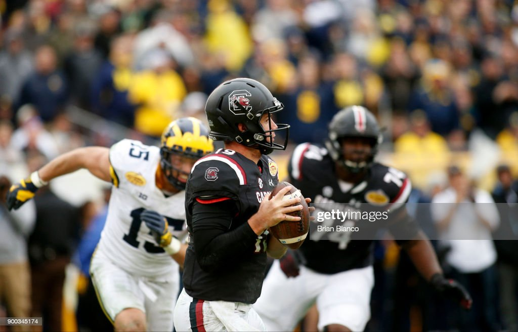Quarterback Jake Bentley #19 of the South Carolina Gamecocks looks for a receiver during the third quarter of the Outback Bowl NCAA college football game against the Michigan Wolverines on January 1, 2018 at Raymond James Stadium in Tampa, Florida.