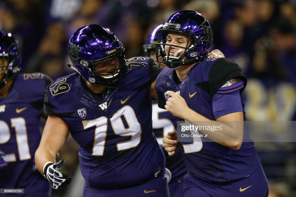 Quarterback Jake Browning #3 of the Washington Huskies celebrates with Coleman Shelton #79 after scoring a touchdown in the second quarter against the California Golden Bears at Husky Stadium on October 7, 2017 in Seattle, Washington.