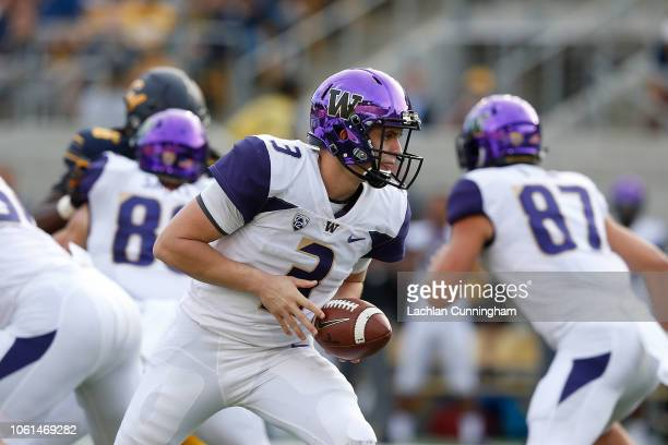 Quarterback Jake Browning of the Washington Huskies looks to hand the ball off against the California Golden Bears at California Memorial Stadium on...