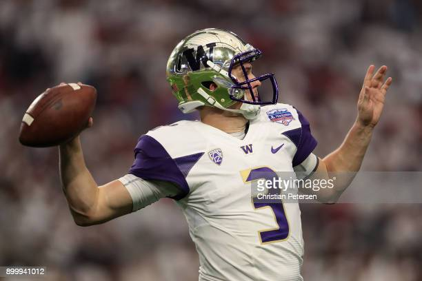 Quarterback Jake Browning of the Washington Huskies throws a warm up pass before the start of the second half of the Playstation Fiesta Bowl against...