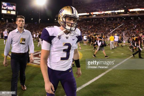 Quarterback Jake Browning of the Washington Huskies walks off the field after being defeated by the Arizona State Sun Devils in the college football...