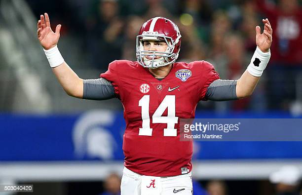 Quarterback Jake Coker of the Alabama Crimson Tide reacts after throwing a sixyard touchdown pass turnover wide receiver Calvin Ridley in the third...