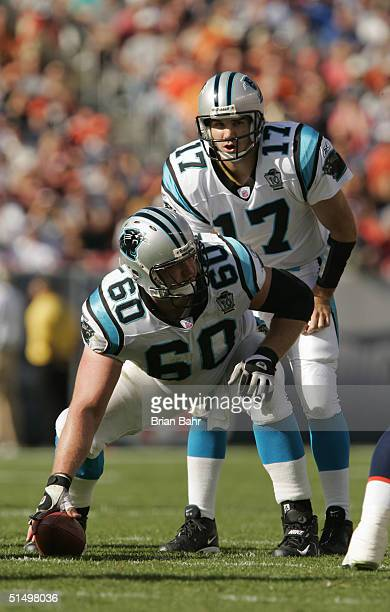 Quarterback Jake Delhomme of the Carolina Panthers and center Jeff Mitchell prepare to snap the ball against the Denver Broncos at Invesco Field on...