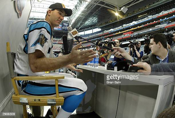 Quarterback Jake Delhomme of the Carolina Panthers answers questions on media day January 26, 2003 at Reliant Stadium before Super Bowl XXXVIII...