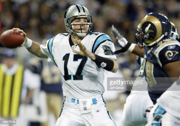Quarterback Jake Delhomme of the Carolina Panthers gets a pass off despite the pressure from Ryan Pickett of the St. Louis Rams in the NFC Divisional...