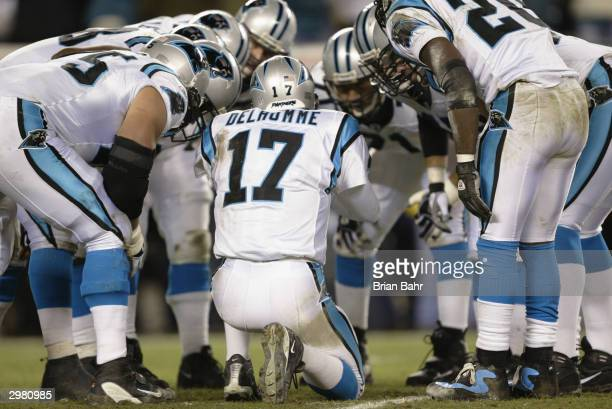 Quarterback Jake Delhomme of the Carolina Panthers in the huddle against the Philadelphia Eagles in the NFC Championship game on January 18, 2004 at...