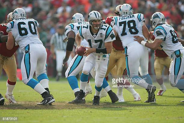 Quarterback Jake Delhomme of the Carolina Panthers looks to hand off the ball against the San Francisco 49ers as offensive tackle Todd Fordhamand and...