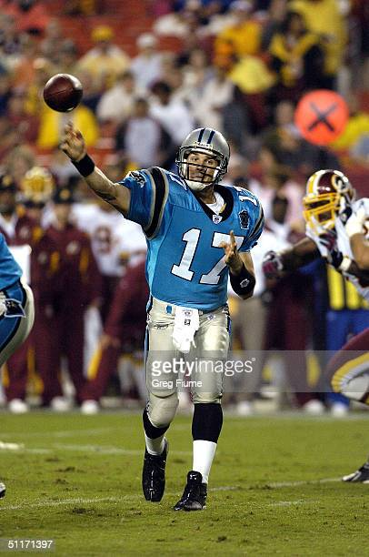 Quarterback Jake Delhomme of the Carolina Panthers throws a pass against the Washington Redskins on August 14 2004 at Fed Ex Field in Landover...