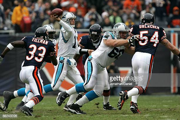 Quarterback Jake Delhomme of the Carolina Panthers throws under pressure from Charles Tillman and Alex Brown of the Chicago Bears as Jeff Mitchell of...