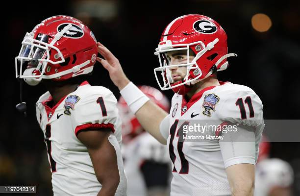 Quarterback Jake Fromm of the Georgia Bulldogs celebrates with wide receiver George Pickens during the first quarter against Baylor Bears during the...