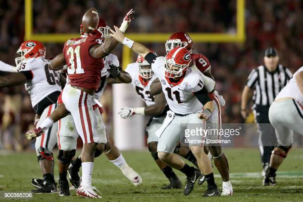 Quarterback Jake Fromm of the Georgia Bulldogs flips the ball and is called for intentional grounding in the second half against the Oklahoma Sooners...