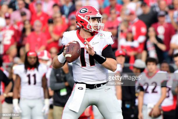 Quarterback Jake Fromm of the Georgia Bulldogs looks to pass in the first half against the Oklahoma Sooners in the 2018 College Football Playoff...