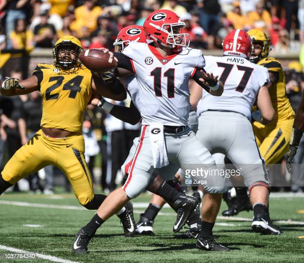 Quarterback Jake Fromm of the Georgia Bulldogs passes against the Missouri Tigers in the first quarter at Memorial Stadium on September 22 2018 in...