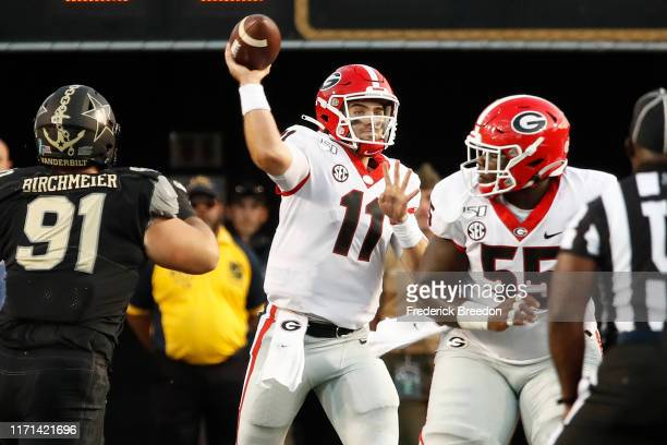 Quarterback Jake Fromm of the Georgia Bulldogs throws a pass against the Vanderbilt Commodores during the first half at Vanderbilt Stadium on August...