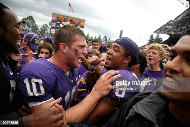 Quarterback Jake Locker of the Washington Huskies celebrates with free safety Nate Williams after defeating the USC Trojans 16-13 on September 19,...