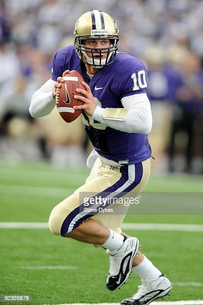 Quarterback Jake Locker of the Washington Huskies looks for an open receiver as he rolls out in the second quarter of the game against the Oregon...