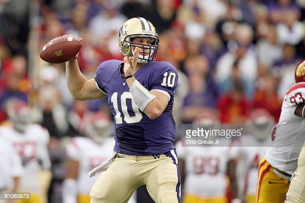 Quarterback Jake Locker of the Washington Huskies looks to pass during the game against the USC Trojans on September 19, 2009 at Husky Stadium in...