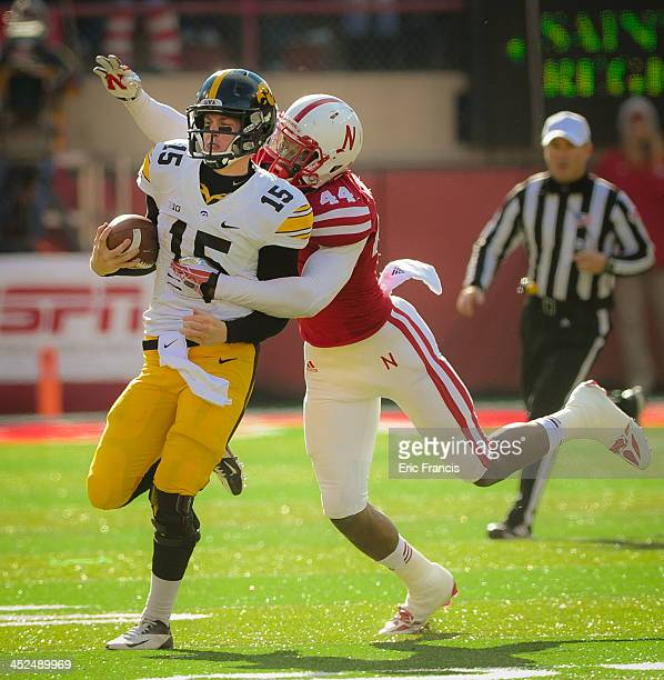 Quarterback Jake Rudock of the Iowa Hawkeyes is chased down by defensive end Randy Gregory of the Nebraska Cornhuskers during their game at Memorial...