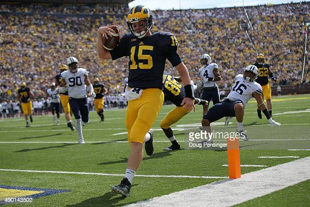 Quarterback Jake Rudock of the Michigan Wolverines carries the ball 17 yards for a touchdown against the Brigham Young Cougars to take a 280 lead in...
