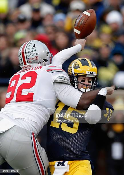 Quarterback Jake Rudock of the Michigan Wolverines fumbles the ball while being hit by Adolphus Washington of the Ohio State Buckeyes in the third...