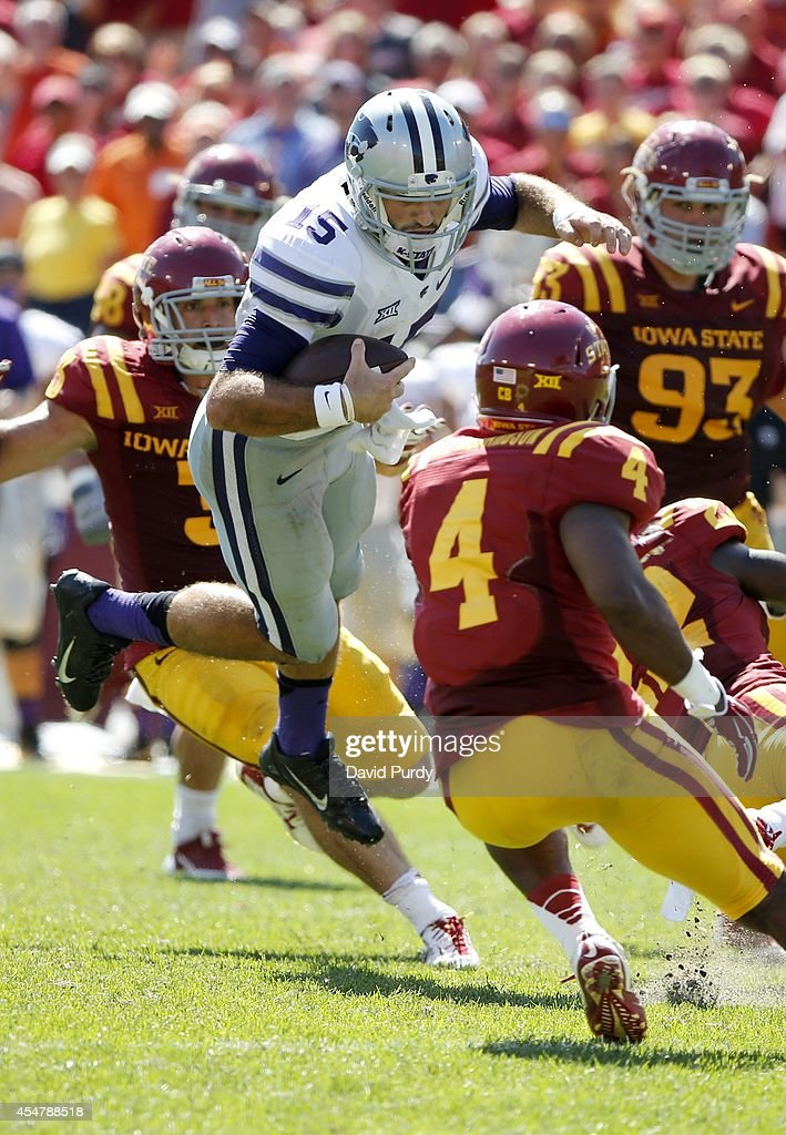 Quarterback Jake Waters #15 of the Kansas State Wildcats dives past defensive back Sam E. Richardson #4 and defensive lineman Brandon Jensen #93 of the Iowa State Cyclones in the second half of play at Jack Trice Stadium on September 6, 2014 in Ames, Iowa. Kansas State won 32-28 over the Iowa State Cyclones.