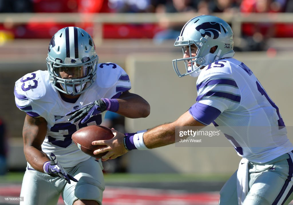 Quarterback Jake Waters #15 of the Kansas State Wildcats hands the ball to John Hubert #33 of the Kansas State Wildcats during game action against the Texas tech Red Raiders on November 9, 2013 at AT&T Jones Stadium in Lubbock, Texas. The Kansas State Wildcats won the game 49-26.