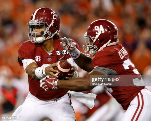 Quarterback Jalen Hurts handoff to Runningback Damien Harris of the Alabama Crimson Tide during the 2017 College Football Playoff National...