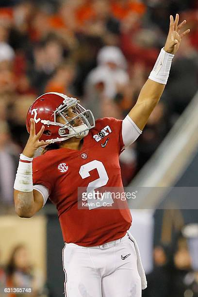 Quarterback Jalen Hurts of the Alabama Crimson Tide celebrates after throwing a 68yard touchdown pass during the third quarter against the Clemson...