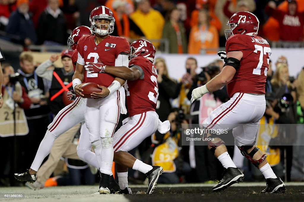 Quarterback Jalen Hurts #2 of the Alabama Crimson Tide celebrates with teammates after rushing for a 30-yard touchdown during the fourth quarter against the Clemson Tigers in the 2017 College Football Playoff National Championship Game at Raymond James Stadium on January 9, 2017 in Tampa, Florida.