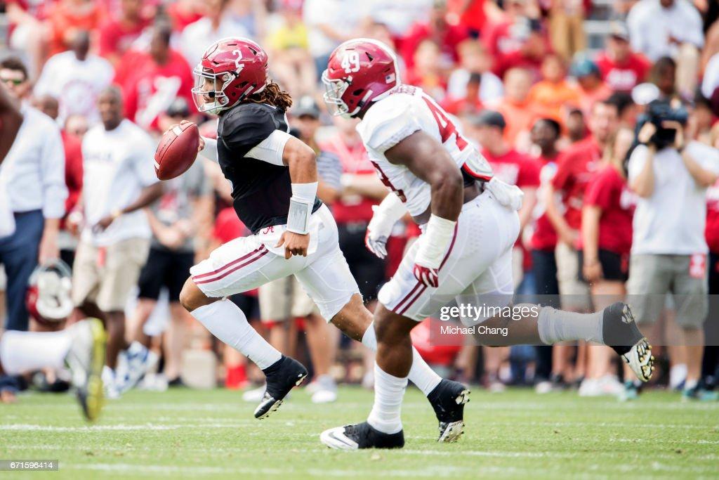 Quarterback Jalen Hurts #2 of the Alabama Crimson Tide scrambles the ball by defensive lineman Isaiah Buggs #49 of the Alabama Crimson Tide at Bryant-Denny Stadium on April 22, 2017 in Tuscaloosa, Alabama.