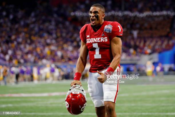 Quarterback Jalen Hurts of the Oklahoma Sooners reacts before the game against the LSU Tigers in the Chick-fil-A Peach Bowl at Mercedes-Benz Stadium...