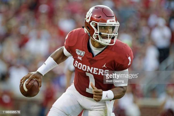Quarterback Jalen Hurts of the Oklahoma Sooners scrambles against the South Dakota Coyotes at Gaylord Family Oklahoma Memorial Stadium on September 7...