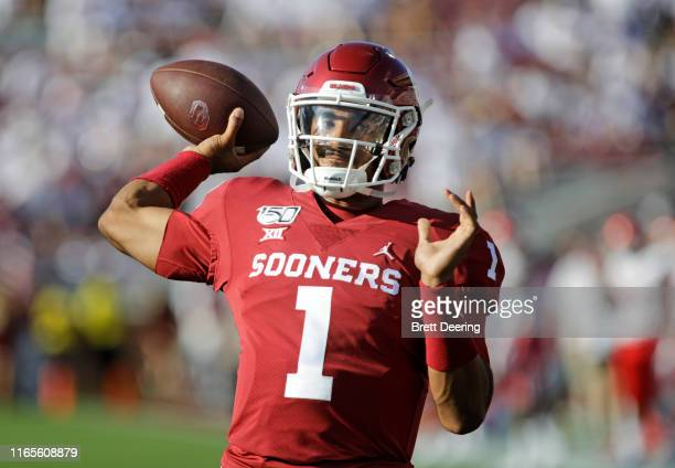 Quarterback Jalen Hurts of the Oklahoma Sooners warms up before the game against the Houston Cougars at Gaylord Family Oklahoma Memorial Stadium on...