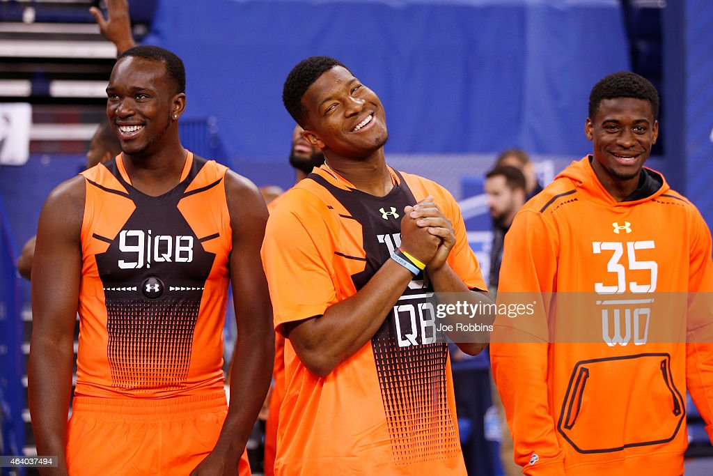 Quarterback Jameis Winston of Florida State jokes with quarterback Jerry Lovelocke of Prairie View A&M and wide receiver DeVante Parker of Louisville during the 2015 NFL Scouting Combine at Lucas Oil Stadium on February 21, 2015 in Indianapolis, Indiana.