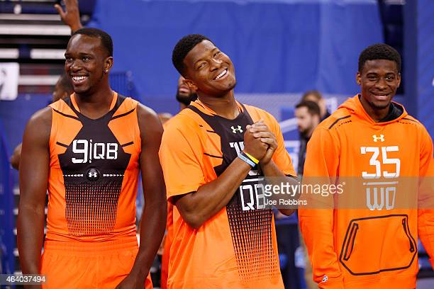 Quarterback Jameis Winston of Florida State jokes with quarterback Jerry Lovelocke of Prairie View A&M and wide receiver DeVante Parker of Louisville...