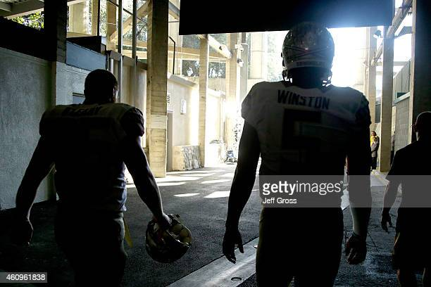 Quarterback Jameis Winston of the Florida State Seminoles and tight end Nick O'Leary stand in the tunnel prior to the College Football Playoff...