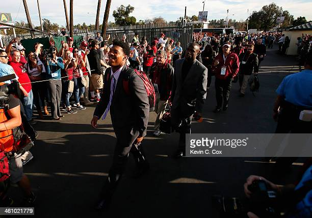 Quarterback Jameis Winston of the Florida State Seminoles arrives prior to the 2014 Vizio BCS National Championship Game against the Auburn Tigers at...