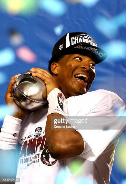 Quarterback Jameis Winston of the Florida State Seminoles celebrates on stage after defeating the Duke Blue Devils 45-7 in the ACC Championship game...