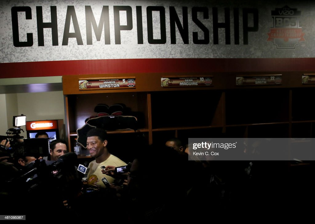 Quarterback Jameis Winston #5 of the Florida State Seminoles celebrates in the locker room after defeating the Auburn Tigers 34-31 in the 2014 Vizio BCS National Championship Game at the Rose Bowl on January 6, 2014 in Pasadena, California.