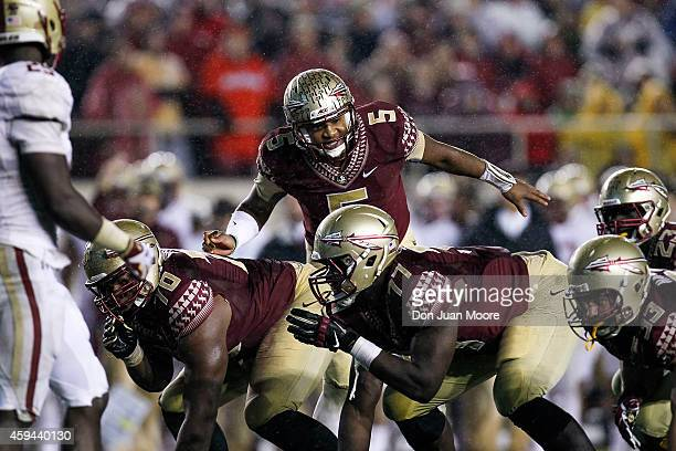 Quarterback Jameis Winston of the Florida State Seminoles change the play at the line of scrimmage during the game against the Boston College Eagles...