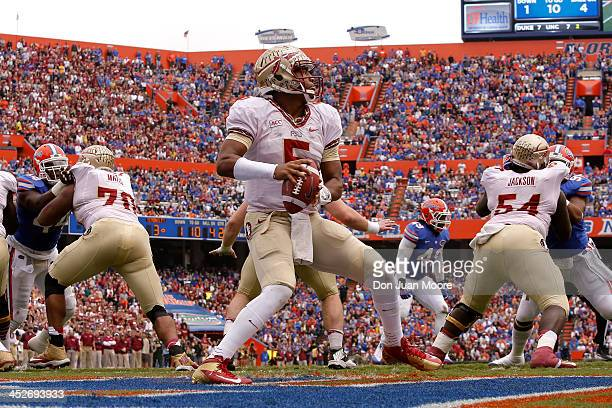 Quarterback Jameis Winston of the Florida State Seminoles during a passing play during the game against the Florida Gators at Ben Hill Griffin...