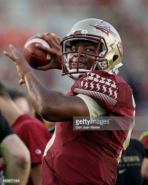 Quarterback Jameis Winston of the Florida State Seminoles during warmups before the game against the Clemson Tigers at Doak Campbell Stadium on Bobby...